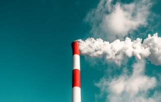 Emissions rise from a tower