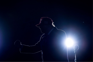 A photograph of Donald Trump holding a microphone