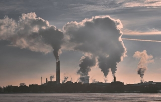 Emissions rise from cooling towers