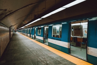A near-empty Montreal Metro train arrives at a station