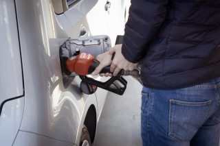 A person fills up the gas tank of their car