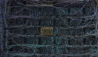 The back of a computer server showing colour wires