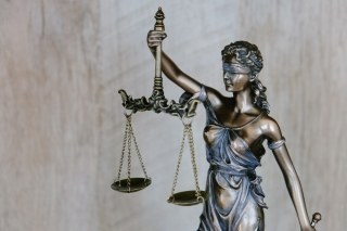 A statue of Lady Justice, blindfolded and holding scales