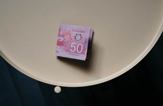 $50 Canadian bills on a table