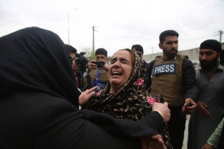 A Sikh woman in Afghanistan weeps following an attack on religious minorities in Afghanistan