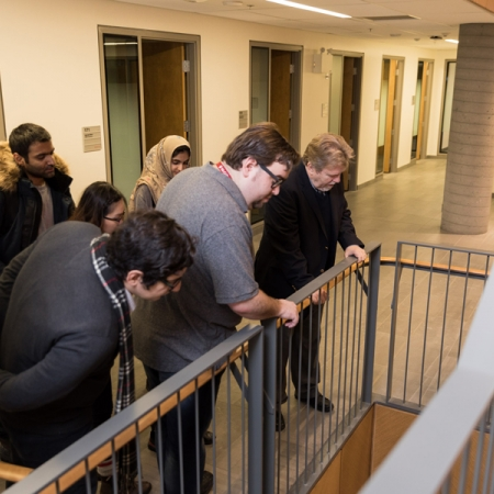 Alfred Jaeger, Academic Director, MBA & PMBA, giving a building tour to a group of MBA students.