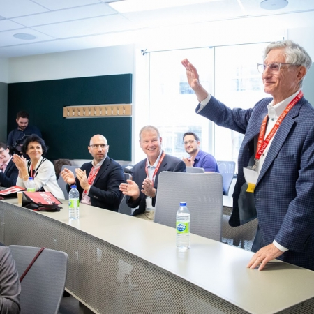 Arthur Dalfen (BCom'60) is applauded for his support of the Arthur Dalfen Classroom in the Donald E. Armstrong Building.