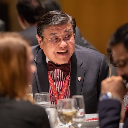 Henry H.S. Lam (BCom'78) enjoys the conversation at the table.