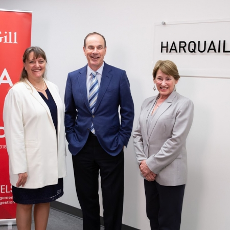 Dean Isabelle Bajeux and Principal Suzanne Fortier pose with David Harquail, MBA'81.