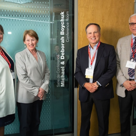 Dean Isabelle Bajeux and Principal Suzanne Fortier pose with Mike Boychuk, BCom'77 and fellow Board of Governors Member and Chair, Ram Panda (MEng'71, MBA'77).