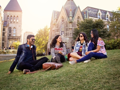 A group of students on the grass in front of the Redpath Museum