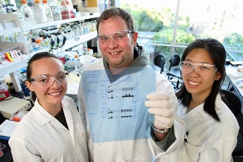 Three graduate students in lab