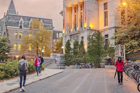 Students walking on McGill campus at dusk
