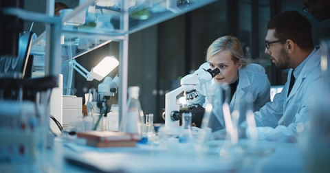 Male and female researchers working together in laboratory