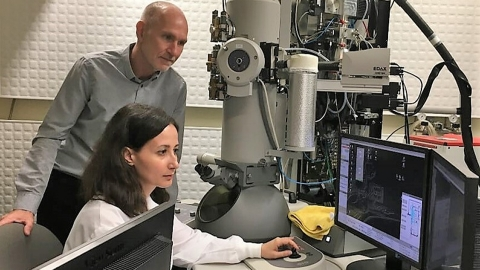 Electron Microscope and researcher