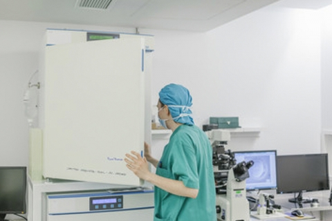 Researcher opening fridge