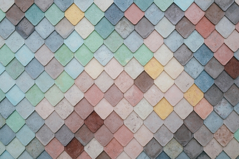 Diamond shaped tiles coloured in shades of blue, green, rose, yellow and red.