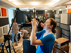 Sound recording student testing microphone
