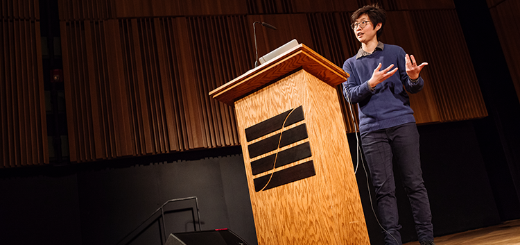 Lena Heng standing at lectern during a 2018-19 Research Alive Series event