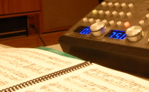 Close up of score and audio instrument in CIRMMT's critical listening lab, Schulich School of Music