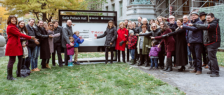 Descendants and extended family of Maurice Pollack joined Dean Brenda Ravenscroft of the Schulich School of Music to inaugurate a new Pollack Hall sign.