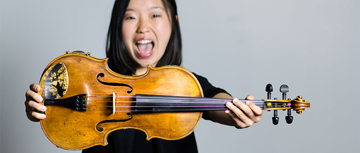 B.Mus. student Grace Takeda with her viola.