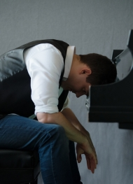 Jarred Dunn, sitting with head on piano keys