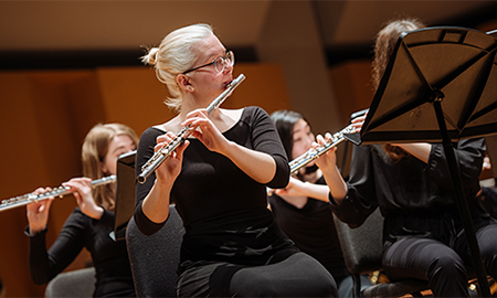 students playing flutes in concert