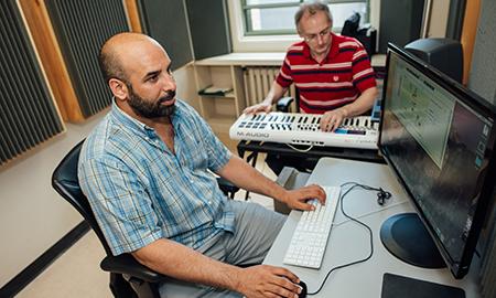 two men in composition area studio