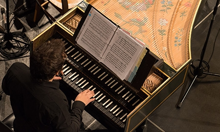 Close-up of student playing one of the Schulich School of Music's harpsichords (McGill University)