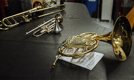 Brass instruments laying on a table