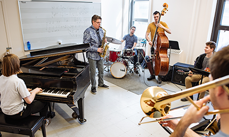 Professor REmi Bolduc plays with jazz combo
