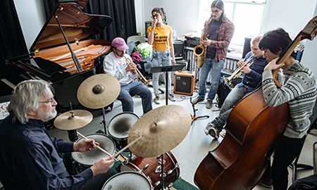 Jazz musicians playing in a circle