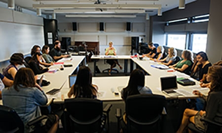 Professor sitting in classroom with students