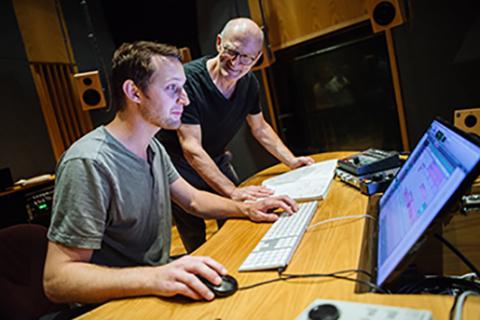 two men in sound recording studio