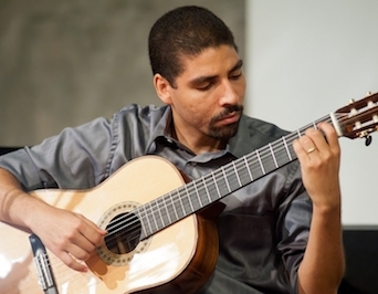 Eduardo Meneses playing guitar