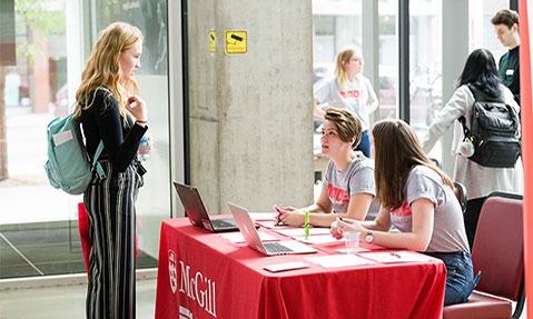 students at event registration desk