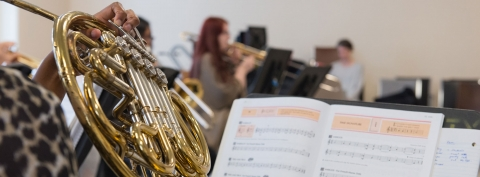 close up of student playing french horn