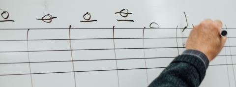 Professor writing notation on white board, Schulich School of Music, McGill University