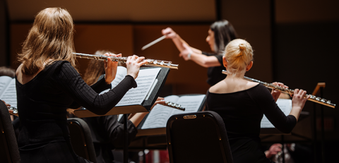 Female conductor with wind orchestra