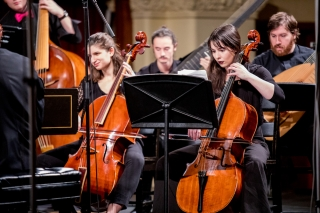 The strings section of the Baroque Orchestra in performance