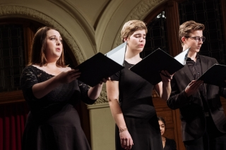 Three singers from Cappella Antica in performance