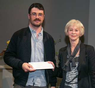Gabriel Dufour-Laperrière receiving the Composition Prize from Mrs Lauraine Cadoret from Fondation Père Lindsay at the Gala Ceremony on May 25.