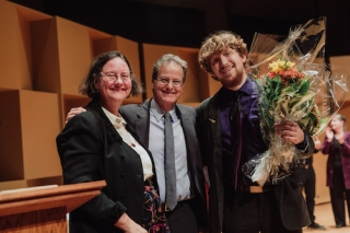 Cellist Joshua Morris with Dean Julie Cumming and Jury Chair Douglas McNabney Credit; Brent Calis