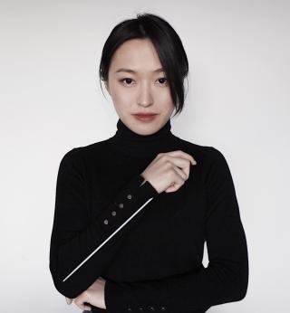 Kelly Lin holding a conducting baton