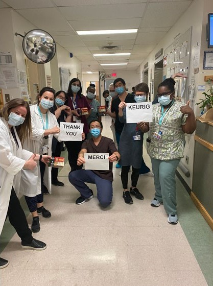 "Frontline Neuro Staff posing with signs that say ""Thank You"""