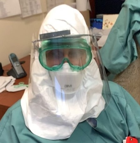 A member of our Neuro Staff using a face shield donated to The Neuro.