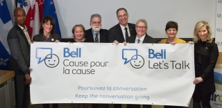 From left, Michel Mpambara, Bell Let's Talk spokeperson, Kathleen Weil, Minister of Immigration, Diversity and Inclusiveness, Martine Turcotte, Québec Vice Chair, Bell, Laurence Kirmayer, Professor and project leader, McGill University, David Eidelman, Vice-Principal (Health Affairs), Dean of the Faculty of Medicine, McGill University, Gaétan Barrette, Minister of Health and Social Services, Monique Vallée, Executive Committee Member in charge of social and community development and homelessness, and Lori G
