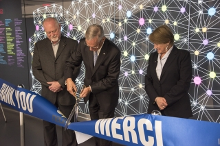 From left, Dr. Guy Rouleau, Director of The Neuro, Jacques Bougie, Co-Chair of the Thinking Ahead Campaign and Chair of the Neuro Advisory Board, and Suzanne Fortier, Principal and Vice-Chancellor of McGill University, cut the ribbon at the donor wall unveiling.