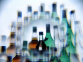 Wine and hard liquor bottles photographed through a multiprism filter.
